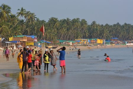 downshift: Palolem, India - October 21, 2015 - Tourist from India and allover the world walking and swimming at the beach of Palolem, Goa. Editorial