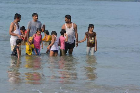 downshift: Palolem, India - October 23, 2015 - Tourists from India and allover the world walking and swimming at the beach of Palolem, Goa.