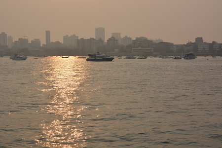 particulate: Smog pollution in Mumbai, India seen from sea during sunset