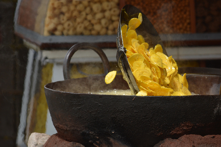 south india: Kochi, India - October 31, 2015 - Frying banana chips in Kochi, Kerala, South India Stock Photo