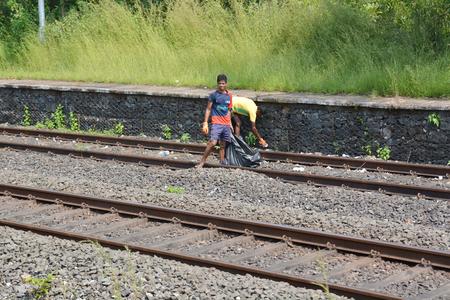 poor children: Mumbai, India - October 19, 2015 - Poor children on the rails of Mumbai. Editorial