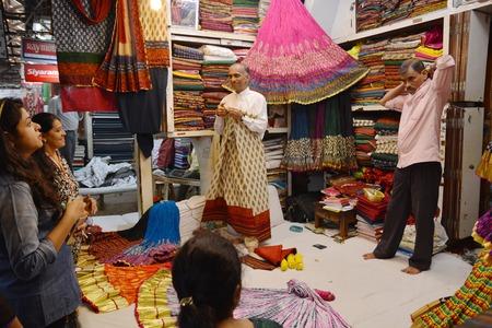 Mumbai, India - October 19, 2015 - Indian trades presenting fabric on market in Mumbai