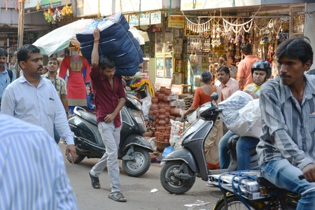carriers: Mangalore, India - October 19, 2015 - Crowded market road in Mumbai with carriers
