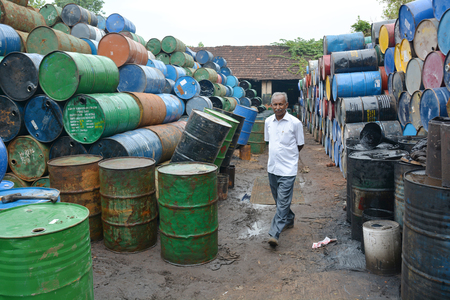 recycles: Kochi, India - November 7, 2015 - Indian owner of a company that cleans and recycles oil barrels