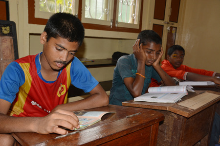 unicef: Mumbai, India - October 27, 2015 - Children from children´s home learning and studying powered by chartiy project based in Europe, reading in books, writing and drawing