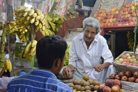 local 27: Mumbai, India - October 27, 2015 - Indian trader in his shop on local market selling all kind of goods
