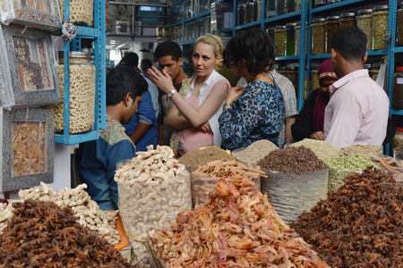bargaining: Kochi, India - November 6, 2015 - Clients bargaining and buying fresh spices in indian shop Editorial