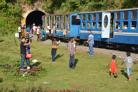 toy train: Mettupalayam, India - October 29, 2015 - Tourists in front of famous toy train