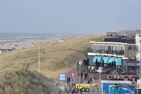dutch girl: Egmond aan Zee, Netherlands - March 26, 2016: People on beach in Noordholland during spring