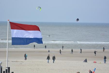 dutch girl: Bergen aan Zee, Netherlands - March 26, 2016: People on beach in Noordholland during spring