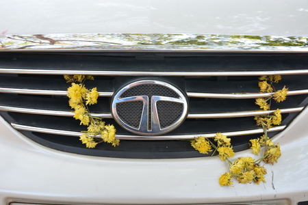 superstition: Kochi, India - October 24, 2015 - Flowers on Tata car in India as part of superstition to prevent car accidents
