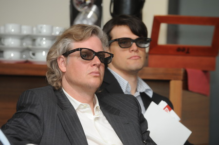 Berlin, Germany- May 26, 2009 - Business men with 3d glasses listening on trade show and conference in Berlin Editorial