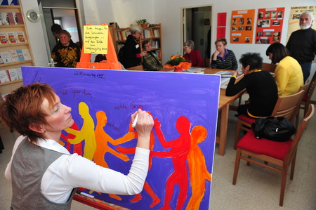 Frankfurt, Germany- March 8, 2010 - Woman painting picture in self-help group for womem