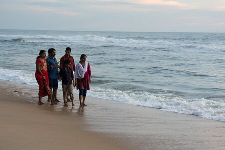 varkala: Varkala, India - December 11, 2016 - People and pilgrims praying at holy beach Varkala in Kerala, South India and taking a bath in the holy water