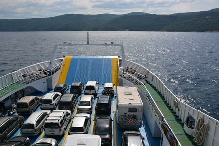 mode: Cres, Croatia - June 16, 2017 - Car ferry on its way to island Cres Editorial