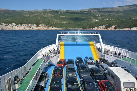 Cres, Croatia - June 16, 2017 - Car ferry on its way to island Cres Editorial
