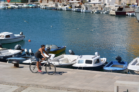 Cres, Croatia - June 19, 2017 - City of cres with boats and fishing boat