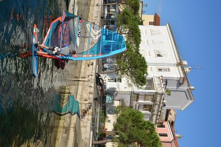 Volosko, Croatia - June 11, 2017 - City of Volosko belonging to Opatja with surfer Editorial