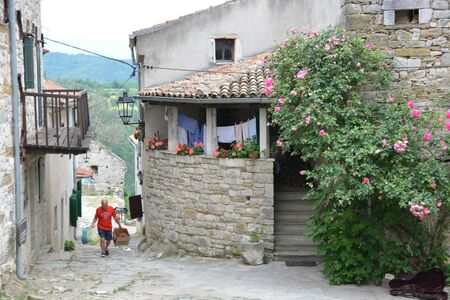 Hum, Croatia - June 14, 2017 - Smallest city of the world, Hum in Croatia with tourists Editorial