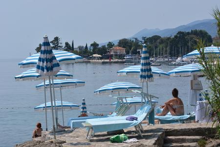Opatija, Croatia - June 13, 2017 - Sunbathing and swimming by Lungomare promenade near Opatija