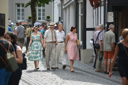 Monschau, Germany - July 22, 2017: People in old-fashioned clothing walking through Monschau