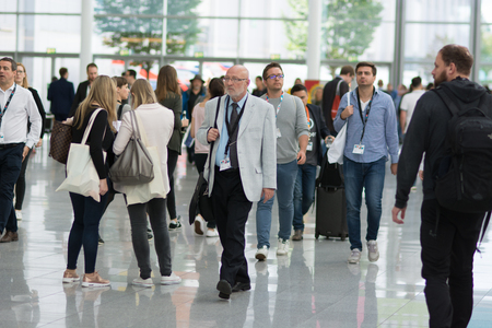 Cologne, Germany - September 19, 2017 - Young business people at digital marketing exhibition and trade show Dmexco in Cologne Editorial