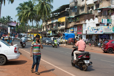Goa, India - July 8, 2018 - Pedestrian in typical traffic situation on indian street in Canacona - Goa Editorial