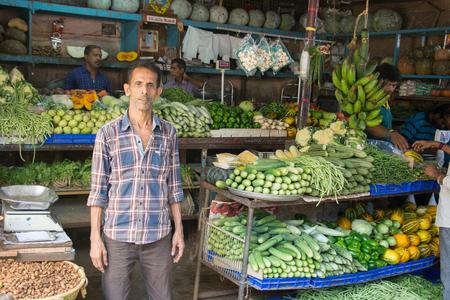 Mumbai, India - July 8, 2018 - Vendors on market selling food - India