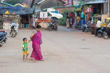 Goa, India - July 8, 2018 - Women on indian street in Gokarna