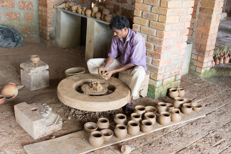 Mumbai, India - July 8, 2018 - Indian craftman doing pottery in a vocational school