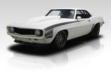 White 1969 era Muscle car on gradient background Imagens