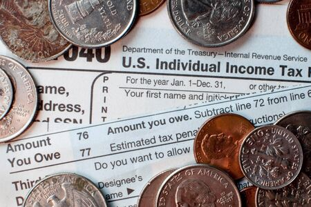 Tax forms and coins Stock Photo