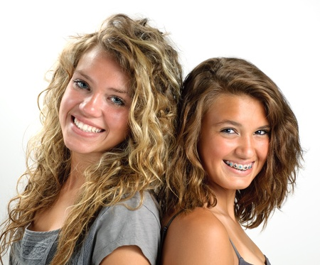 cute braces: Two sisters back to back smiling