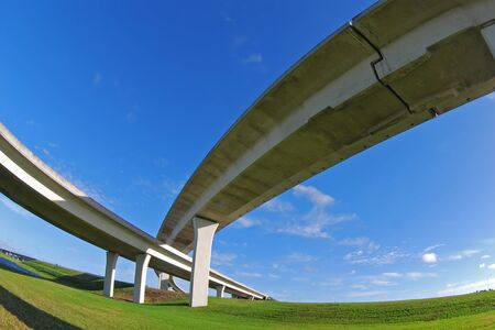 Sweeping expressway on clear blue sky photo