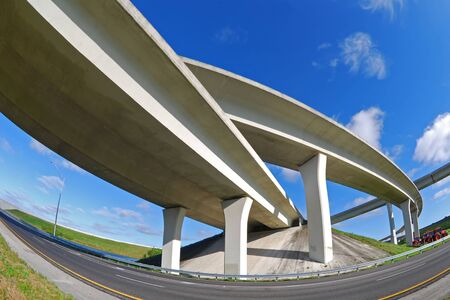 Sweeping expressway on clear blue sky