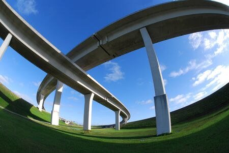 roadway: Sweeping expressway on clear blue sky