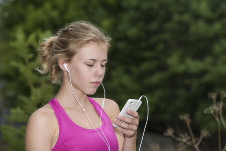 Young teenage girl working out photo