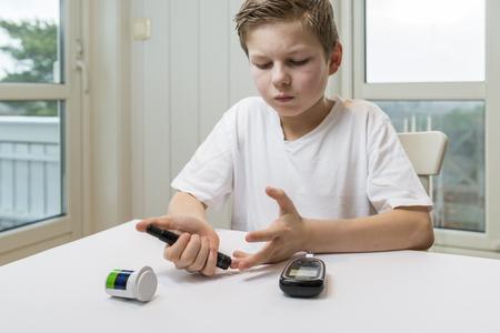 suger: Boy measure glucose or blood suger level