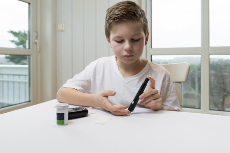 Boy measure glucose or blood suger level
