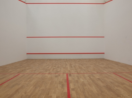 Official white squash court in a squash club Фото со стока