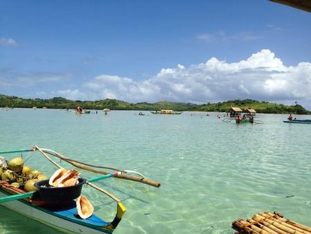 sandbar: clear water and fishermen