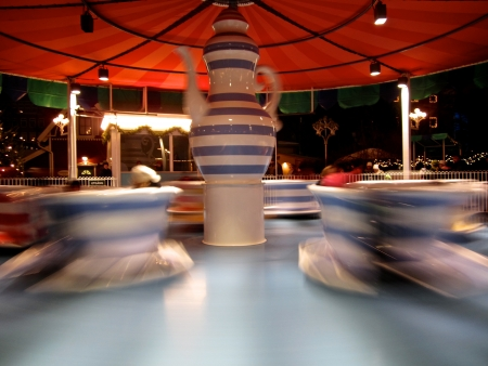 Teacups moving in an amusement park.