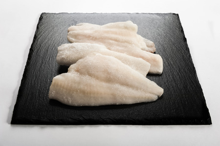 frozen fish: Frozen fish on a stone plate Stock Photo