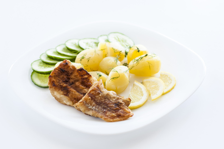 fish and potatoes on white plate