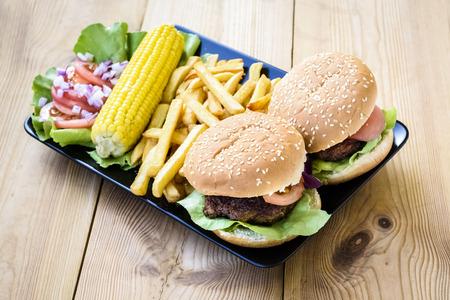 American food - hamburgers, fries, corn
