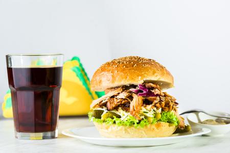 Pulled pork burger on white plate