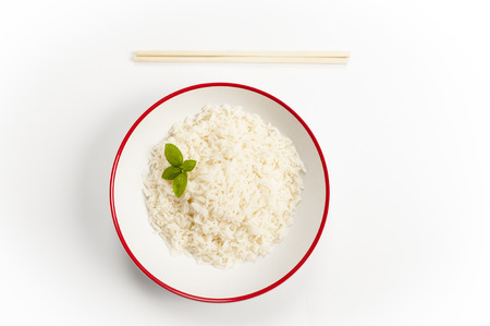 a bowl of rice on a bamboo mat Stock Photo