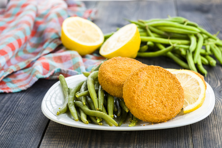 bean sprouts: Fish burgers served with green bean sprouts Stock Photo