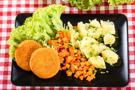 fish burgers, potatoes and carrots and peas are tasty and healthy lunch
