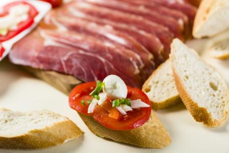 bruschetta with tomatoes, mozzarella, Parma ham and basil - seasoned with oregano